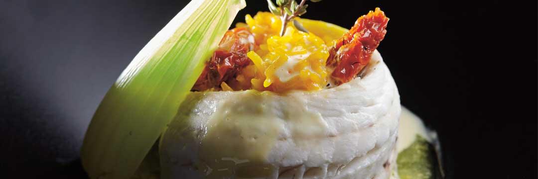 Filet de vive, risotto au safran et tomates confites
